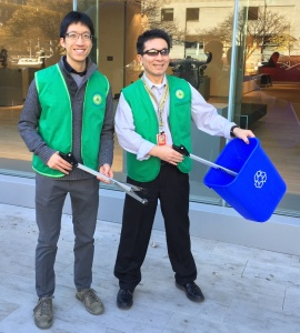 Veng and Nathaniel showcase the Recycling Rescue Tools, while sporting their snazzy green team vests