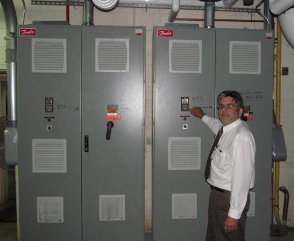 Figure 6 Angelo Bruni, TWH Facilities Manager with the new 250 hp VFDs installed at chiller plant.