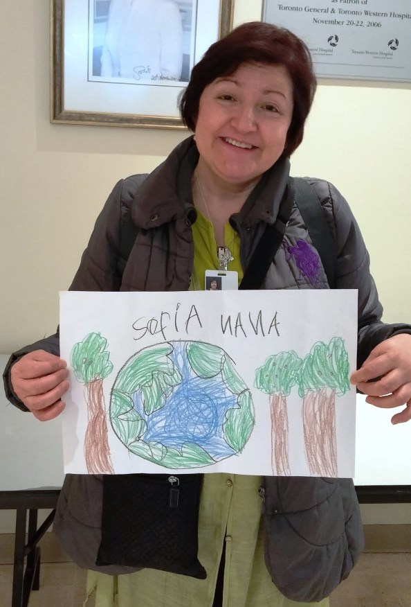 Maria Yepes with her grandchild's Earth Day Drawing