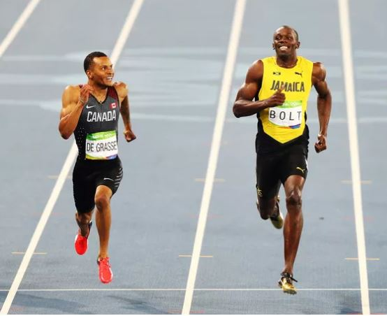 Andre De Grasse and Usain Bolt grin at the finish. Image credit: SB nation