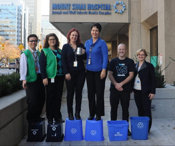 The WRW Olympic Podium! Sinai Health Systems won the gold, University Health Network won silver and SickKids won bronze. Balancing on the blue bins was not as easy as it looked! (L-R: Veng Chhin, Lisa Vanlint, Tracey Clatworthy, Brenda O'Connor, Craig Urekar, Elisabeth Perlikowski)