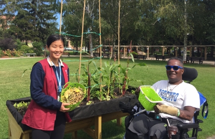Bickle Garden, Shan Lee (volunteer) helping Elbonne James (patient) tend the garden. Fantastic and fun therapy program!